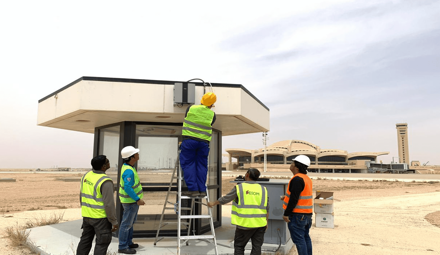 Oizom Team installing Polludrone Outdoor Air Pollution Sensor in Riyadh airport for monitoring ambient air quality.